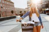 Young stylish woman with a bicycle — Stock Photo
