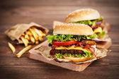 Delicious hamburger and fries — Stock Photo
