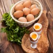 Boiled eggs on a wooden background — Stock Photo #79175398