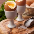 Boiled eggs on a wooden background — Stock Photo #79297386