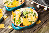 Nachos with melted cheese — Stock Photo