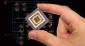 Microprocessor in hand over circuit schematic — Stock Photo