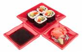 Rolls with vegetables on plate, soy sause, ginger, wasabi — Stock Photo
