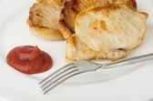 Fried pork cutlet, tomato sauce on plate — Stock Photo