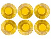 Six bottle of vegetable oil, top view — Stock Photo