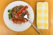 Grilled sausage with ketchup and buckwheat  and towel — Foto Stock