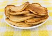 Plate with Russian pancakes on cloth — Stock Photo