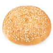 Appetizing bun sprinkled with sesame seeds — Stock Photo #70657883
