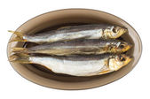 Three herring in black transparent glass plate — Stock Photo