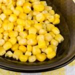 Sweet corn in black oval dish closeup — Stock Photo #70938493