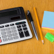 Electronic calculator, paper, pen, sharpener  and pencil — Stock Photo #71124681
