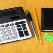 Electronic calculator, notepad, pen, sharpener  and pencil — Stock Photo #71124685