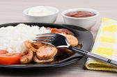 Close up of plate with rice, sausage, tomatoes, ketchup, mayonna — Stock Photo