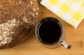 Russian kvass in mug, round loaf of bread on board — Stock Photo