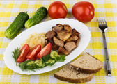 Roast pork with herbs and vegetables in platter — Stock Photo