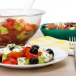 Transparent glass bowl and plate with Greek salad, fork, napkin — Stock Photo #74781611
