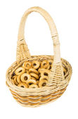 Small bread rings in wicker basket with handle — Stock Photo
