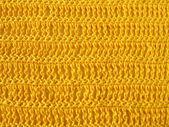 Crochet pattern from single and triple crochet stitch in yellow — Stockfoto