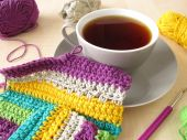 Crochet work and a cup of coffee — Стоковое фото
