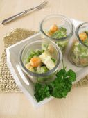 Fish and vegetables on rice in glasses — Stock Photo