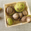 Shellbark hickory nuts in small basket — Stock Photo #63971463