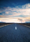 Road under a dramatic sky — Stock Photo