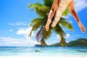 Woman's legs on palm — Foto Stock