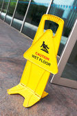Warning sign slippery  — Stock Photo