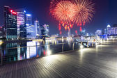 Firework and night view of prosperous city  — Stock Photo
