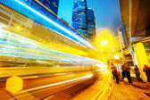 Traffic light trails in modern business city — Stock Photo