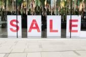 Sale poster in the fashion shopfront — Foto de Stock