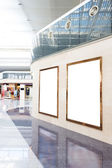 Blank poster board wall in modern shopping mall — Stock Photo
