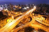 Modern city traffic and skyline at night Shanghai. — Stock Photo
