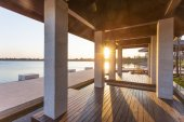 Resort lakeside pavilion at sunset — Stock Photo
