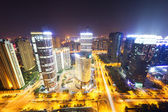 Traffic trails and cityscape at night — Stockfoto