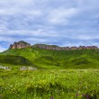 Cloudscape and meadow in tibet highland. — Stock Photo #63618351