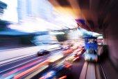Traffic light trails at modern city — Stock Photo