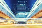 Traffic light trails in modern city — Stock Photo