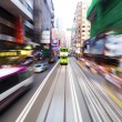 Traffic blur motions in modern city hong kong street — Stock Photo #64666345