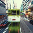 Traffic blur motions in modern city hong kong street — Stock Photo #64668079