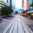 Traffic blur motions in modern city hong kong street — Stock Photo #64669701