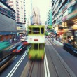 Traffic blur motions in modern city hong kong street — Stock Photo #64670983