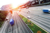 Busy traffic on multi highway lanes during sunset. — Stock Photo