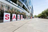 Sale sign in shopping mall showcase — Stock Photo