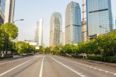 Skyline, urban road and office building — Stock Photo