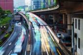 Crowed and fast traffic jams on expressway — Stock Photo