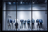 Fashion shop display window and clothes — Stock fotografie