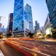 Traffic and office buildings in modern city — Stock Photo #70862327