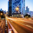 Traffic and office buildings in modern city — Stock Photo #70862397