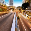 Traffic and office buildings in modern city — Stock Photo #70863625